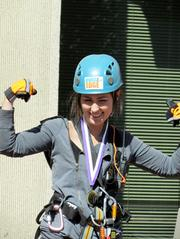 Making a Splash: Big Brothers Big Sisters generated buzz with a rappelling event last September. Kelle Carli, art director of the Dayton City Paper, after making the descent.
