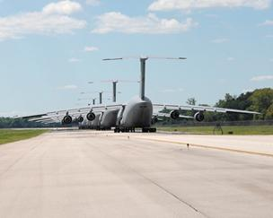 Major Impact: Six C-5 aircraft await departure on the taxiway at Wright- Patt, which is the largest single-site employer in the state of Ohio with more than 27,000 workers.