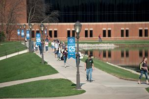 Recruiting college students takes pre-planning to be effective, experts say. Students walk across the campus of Cedarville University in Greene County.