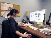Art Director Kelle Carli  works on the paper.