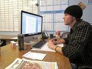 Editor Jordan Mills Pleasant works on the paper.