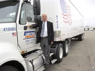 Mike Cronin, executive vice president of Dayton Freight Lines Inc.,  stands on one of the company'€™s trucks at its Huber Heights service  center. Dayton Freight Lines is looking to add a large freight terminal in Minnesota.