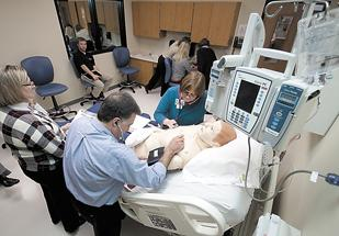 At Greentree Health Science Academy, faculty from Cincinnati State and Miami University Middletown and Hamilton work together on SimMan, an advanced nursing dummy.