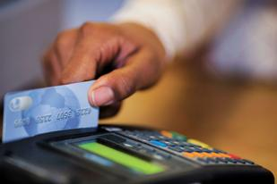 Banks and retailers are fighting over how much stores should pay when consumers pay with debit cards.