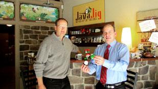 Coffee Growth: Bill Graham, co-owner of Java Jig Coffee, and Jay Otto, also a co-owner, at their downtown Dayton storefront. Otto is holding Java Jig's reusable filter product.