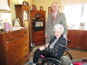 Taking Care: Russell Holtz, executive director of Lincoln Park Manor in Kettering, stands beside Joanne Heyda, a resident