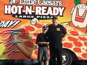 Pizza Pizza: Joe Polasek and his son. Polasek is opening a Little Caesar's pizza restaurant in Bellbrook.