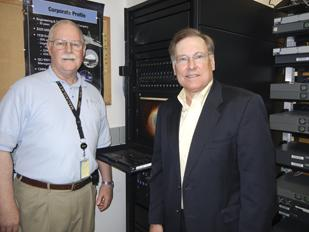 Initiatives: Charlie Schwegman, president of MacAulay-Brown, (right) and Tom Batty, senior vice president of operations, stand in research and development lab used for intelligence work.  The Beavercreek defense firm landed a $1 million Air Force contract for radar testing.