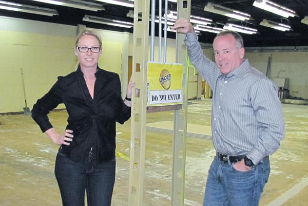 New Deals: Anita Emoff, president of Boost Rewards and Shumsky, and Mike Emoff, CEO of Shumsky, stand in soon-to-be-converted office space. The Dayton promotions company plans to hire six to eight employees in the coming months.
