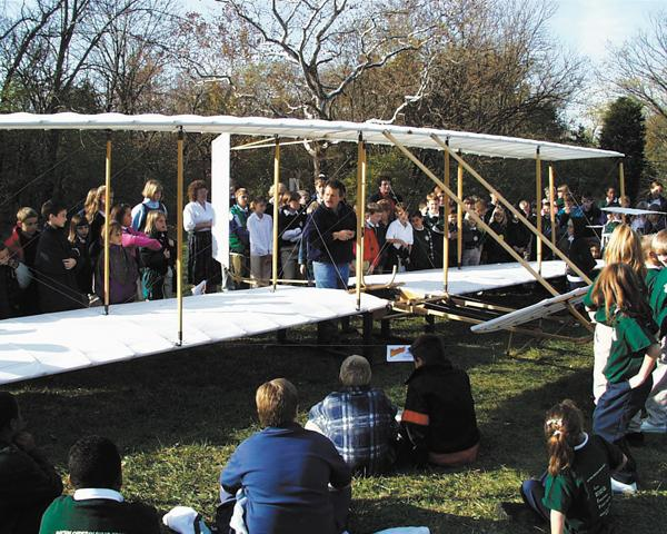 History: Nick Engler demonstrates the 1902 Wright glider to kids at Sugar Creek School north of Dayton. Engler plans to move his collection to a city that will house them as a teaching museum.