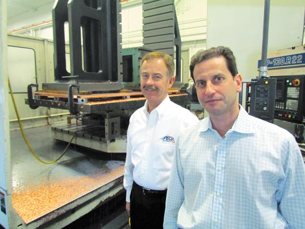 Process Equipment Co. Owner Albert Naggar (right) and CEO Bill Rosenberg  in the company's plant. The manufacturer is expanding and plans to  consolidate in Dayton.
