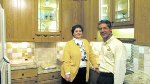 Customer Centric: Beth Spegal, designer, and Erich Eggers, co-owner and president of Centerville-based Remodeling Designs, stand in the company's showroom. The firm saw revenue climb 24 last year after it began a full-out marketing effort to focus on existing customers.