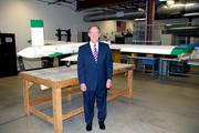 Plans in Action: Dennis Andersh, regional executive for SAIC, stands with a UAV at its Dayton-area facility.
