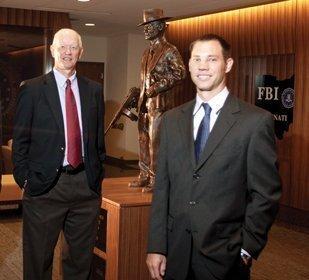 Building Boom: Tom Laine, left, Skanska's senior director of development in Cincinnati, and local project executive Chris Hopper at the FBI's regional field office in Kenwood, which Skanska recently built.