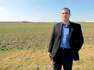 Economic Boom: Jon Crusey, city manager of Tipp City, stands at the site where the new $270M Abbott Laboratories facility will be built.