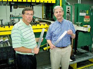 Funding Growth: (Left to right) Ed Leventhal, president and owner of Valco Industries Inc., and Dave Montgomery, general manager, hold files used in the upkeep of horse hooves. The company got a loan for a $700,000 machinery investment.