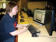 A Wright State student in the school's trading center.