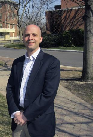 Institutional Growth: Justin Bayer, founder of Welcome to College LLC, stands on the campus of the University of Dayton. The local dot-com has added more colleges to its customer list.