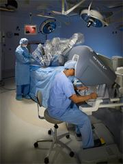 High-Tech Hospitals: Staff using the da Vinci robotic surgery system, which several local hospitals use including West Chester Hospital.