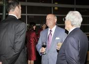 Bob Dunlevey (center) of Dunlevey Mahan & Furry law firm, talks with attendees of the Business of the Year event.