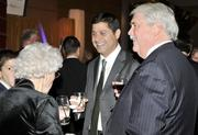 J.P. Nauseef (center) of Myrian Capital, talks with Don Patterson and other attendees of the Business of the Year event.
