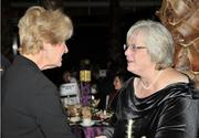 Maureen Patterson (left) and Kim Duncan talk during the Business of the Year event.