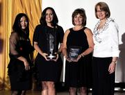Joanne Li (left) of Wright State University and Carol Clark of the  Dayton Business Journal pose with the finalists for the Rookie Business  award. Representing the finalists are Stephanie Smith (middle left) of Lighting Optimizers and Becky Edgren of PuroClean Emergency Services.