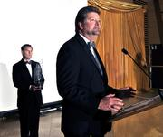 Glenn Costie of the VA Medical Center accepts their award on Thursday.