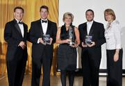 Kevin Robie (left) of Soin International and Carol Clark of the Dayton Business Journal pose with the finalists for the Service Business award. Representing the finalists are David Ganzsarto of Alternate Solutions HomeCare (left to right), Salli Duncan of VRI, and a representative of The Connor Group.