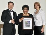 """Idotha """"Bootsie"""" Neal accepts her award as one of Eight Extraordinary Women honors."""