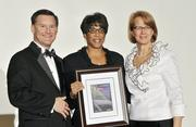 Jenell Ross accepts her award as one of Eight Extraordinary Women honors.