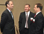David Brixey (center) and Keven Weckesser (right) of sponsor Brixey & Meyer speak with DBJ Ad Director Scott Carlson at the event.