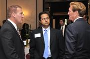 David Brixey (left) of sponsor Brixey & Meyer talks with Vishal Soin (center) of Soin International and Larry Connor (right) of The Connor Group.