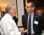 Mark Fornes (left) of Fornes Realty talks with Roger Furrer of First Financial Bank.