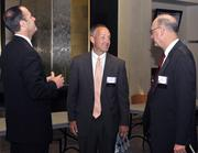 Jeff Hoagland (center) and Joe Zeis, both of the Dayton Development Coalition, talk to DBJ Ad Director Scott Carlson at the 2012 Defense Forum on Tuesday.