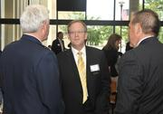 Dennis Andersh (center) of SAIC talks with U.S. Air Force Lt. Gen. Thomas Owen (left) and Michael Bridges of Peerless Technologies during the networking portion of the 2012 Defense Forum on Tuesday.
