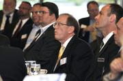 Dennis Andersh of SAIC (center) listens to one of the keynote speakers at the DBJ's 2012 Defense Forum on Tuesday in downtown Dayton.