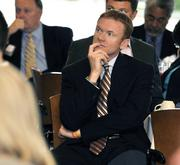 Jerad Barnett of Synergy Building Systems listens to one of the keynote speakers at the DBJ's 2012 Defense Forum on Tuesday in downtown Dayton.