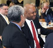 """Maurice """"Mo"""" McDonald of the Dayton Development Coalition talks to another guest at the 2012 Defense Forum on Tuesday."""