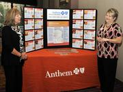 Anthem employees at the company's booth. Anthem was presenting sponsor.