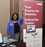 DBJ's Alexis McCain at the DBJ booth at the event.
