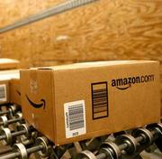 Amazon.com is reportedly planning to open a Cambridge, Mass., office, and has acquired Kiva Systems, a Massachusetts robotics firm, but the move raises questions about the internet retailer's ability to continue avoiding sales tax in the Bay State.