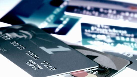 The defendants are accused of fabricating identities to obtain credits cards and doctoring credit reports to pump up the spending and borrowing power associated with the cards.