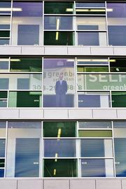 Josh Fine, of Focus Property Group, looks out the window at the company's new Greenbox Self Storage facility at 3310 Brighton Blvd. in Denver's River North neighborhood.