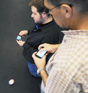Adam Wilson (on the floor), Orbotix chief software architect and founder, and CEO Paul Berberian, demonstrate how Sphero works.