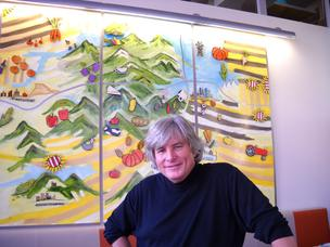 Tom Ryan, owner of Tom's Urban 24, which opens Wednesday, stands in front of a painting of Colorado. It shows where the locally sourced food ingredients come from. The restaurant is at 1460 Larimer St.
