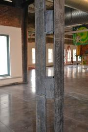 Steel columns are visible throughout the inside of the building.