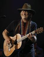 Willie Nelson rides into Red Rocks with a posse