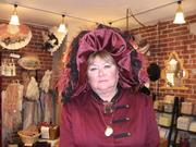 Museum volunteer Janet Kalstrom, dressed as Margaret Brown, is preparing for a voyage that recreate the Titanic's trip between England and New York.