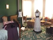 The bedroom once occupied by Margaret Brown is set up as though Brown was packing for a trip.